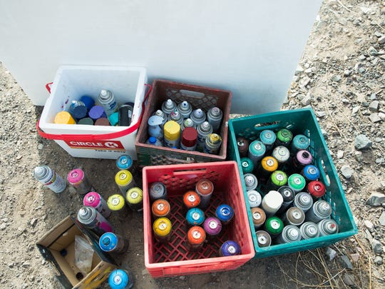 Traveling artist Yao Siao's boxes of spray paint, which he used to paint the mural on the west side of the former West End Art Depot building, 401 N. Mesilla Street, on Dec. 1, 2016. The spray paint was provided by Derrick Pacheco, who is in the process of buying the building.