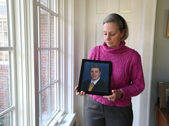 Alison Crowther with a photo of her son, Welles Remy Crowther, at her Upper Nyack home Dec. 1, 2016. Welles was the Man in the Red Bandana, who rescued people before he died at the World Trade Center on Sept. 11.