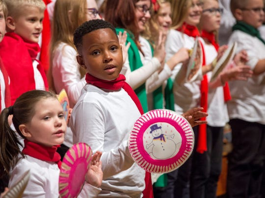 """Members of elementary choirs sing """"Sugar Cookie"""" at the 80th annual Christmas Sing in 2016."""