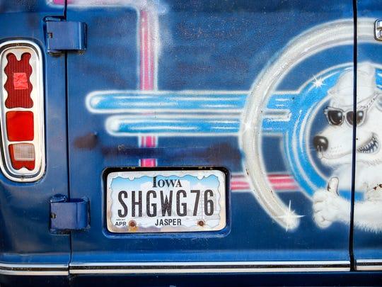 """Dave Bonnett's 1976 Ford Econoline """"Shag Wagon"""" sits"""