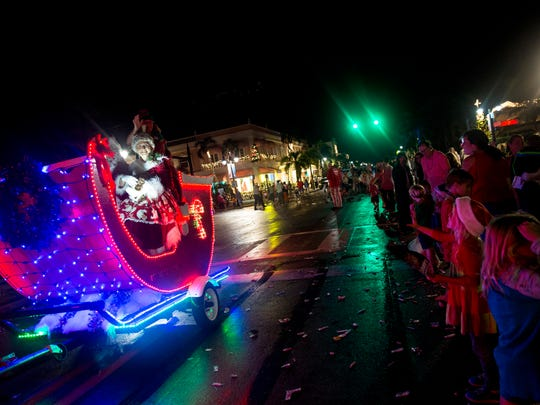 Mrs. Claus waves to the crowd during the Naples Christmas