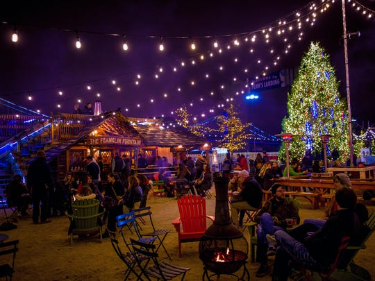 Philadelphia's RiverRink on Penn's Landing offers ice skating, fire pits,craft vendors, music, food and drinks, and a holiday-themed light show.