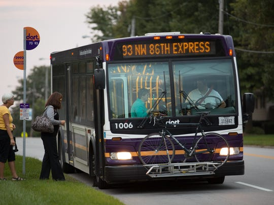 A DART bus picks up passengers in the Des Moines area.
