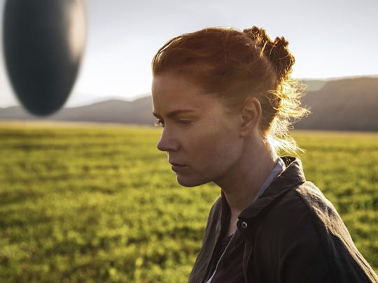 "In ""Arrival"" Amy Adams stars as a linguist tasked by the government with communicating with newly landed aliens. This image released by Paramount Pictures shows Amy Adams in a scene from ""Arrival."""