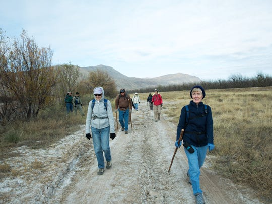 A group of hikers participating in the 50+ Hiking Program, sponsored by the City of Las Cruces, walk the path towards Deer Canyon, north of Las Cruces.