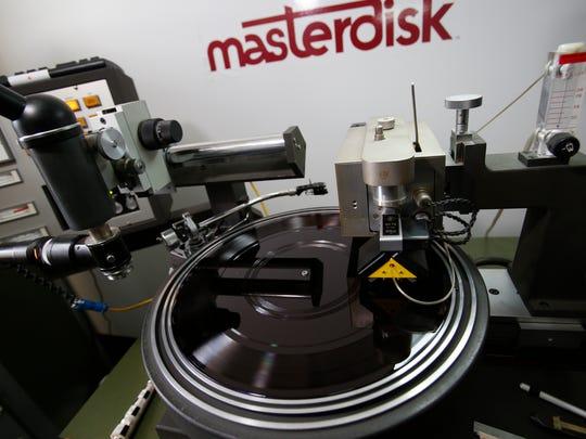 A master record engraving machine at Scott Hull's  Masterdisk studio in Peekskill on Dec. 9, 2016.