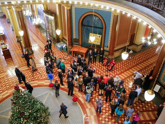 Media and guests gather for the dedication of a Nativity scene placed at the Iowa Capitol by the Thomas More Society on Monday, Dec. 12, 2016.