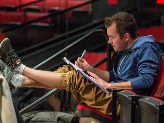 "Mike Draper takes notes as the cast of the play ""No"