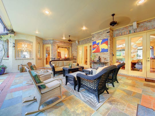The outdoor living area is luxurious and spacious.