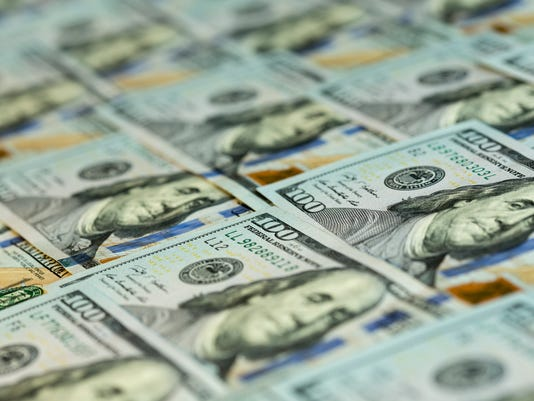 Heap of new US cash in hundred notes
