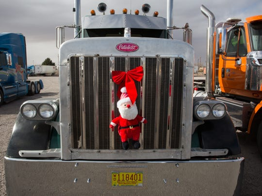 Trucks parked at Border International drove from Vado to Las Cruces loaded with toys Saturday December 17, 2016. The toys will be distributed to children at area hospitals.
