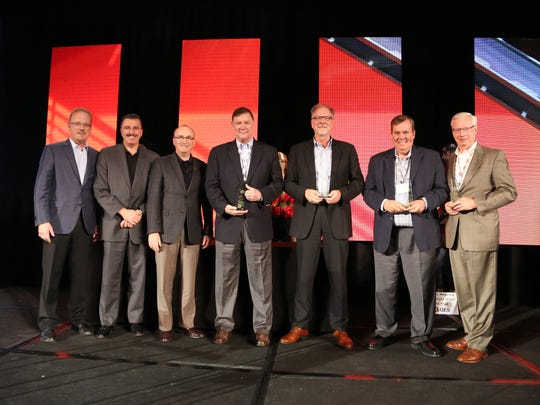 Pictured on far right, Kondex President Jim Wessing