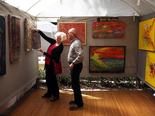 Artist Betty Newman of Marco Island shows Frank Fleischacker
