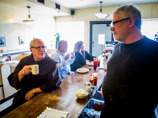 Joe Tucker chats with Brother Tim Sucher at Tucker's Restaurant on Vine Street  Wednesday, December 21, 2016.  Brother Tim is a Pastoral Associate at St. Francis Seraph Church and comes to Tucker's everyday. 