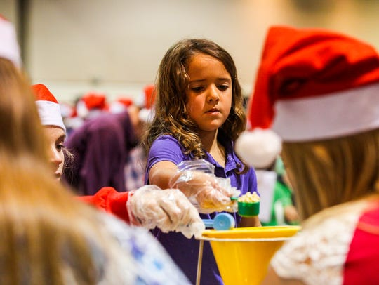 Holidays Without Hunger is an annual food-packaging event hosted by Meals of Hope.