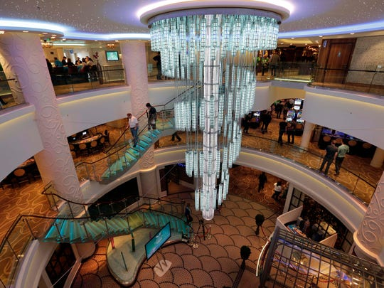 A large chandelier is the focal point of 678 Ocean Place aboard the Norwegian Cruise Line's new ship, Norwegian Breakaway which was christened in New York, Wednesday, May 8, 2013. The ship is themed on New York City, with a colorful mural on the exterior hull design by pop artist Peter Max featuring the city skyline and the Statue of Liberty.