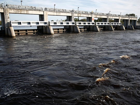 Water churns Wednesday, Feb. 10, 2016, at the W.P. Franklin Lock and Dam in Alva, Fla. The mayors of Lee County‰'s six municipalities convened at a joint emergency meeting on Wednesday to discuss action items regarding freshwater releases from Lake Okeechobee into the Caloosahatchee watershed. It's argued that the release of dark, nutrient-laden freshwater into the the watershed, damage Southwest Florida‰'s economy and ecology. (Corey Perrine/Staff)