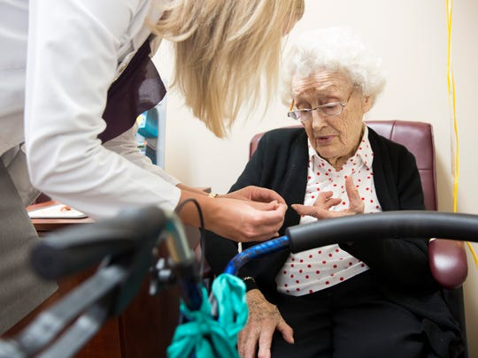 Dorothy Andersson, 99, receives instructions from Life Hearing & Tinnitus Health Center Hearing Specialist Shauna Kleindl on Thursday, Dec. 29, 2016, in North Naples. Andersson received a set of free hearing aids through the clinic. The news came as a complete surprise for Dorothy, who will be turning 100 on Oct. 29, 2017.