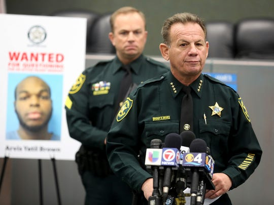 Sheriff Scott Israel of the Broward Sheriff's Office speaks during a news conference to the arrest of Arvis Yatil Brown in connection with the gun violence in Dania Beach that has left 8-year-old Rasheed Cunningham Jr., and Christopher Jordan, 25, dead.
