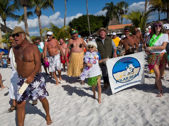 "People make their way to the water during the 12th annual Fort Myers Beach Polar Bear Club Jump at the Outrigger Beach Resort on Sunday, Jan. 1, 2017. ""Get Wet for Willie"" benefited Willie Frey, a Fort Myers Beach resident who has battled cancer for over a year."