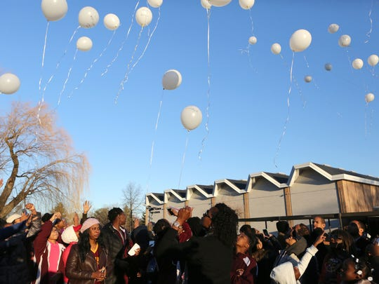 Teammates, friends and family release balloons in memory of Shamoya McKenzie at Mount Vernon High School Jan. 1, 2017. Basketball standout Shamoya McKenzie, 13, was killed by a stray bullet on New Year's Eve when traveling in the passenger seat of her mother's car. The community, her teammates, friends and family gathered to remember at the high school.