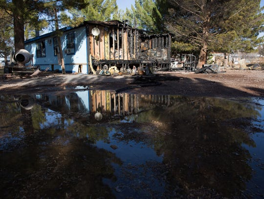 the burnt remains of the Jurado home in La Mesa, Tuesday,