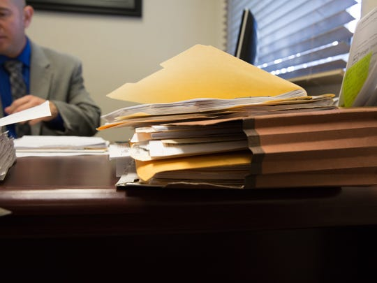 Jacob Avalos, one of the accountants at Lujan and Avalos Accountants, works in his office Tuesday, January 3, 2017, as tax season quickly approaches.