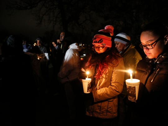 Mourners hold candles during a during a vigil for Frederico Thompson Jr. at Good Park Wednesday, Jan. 4, 2017. Thompson, 18, was shot to death about 3:30 a.m. Sunday outside a southside nightclub.