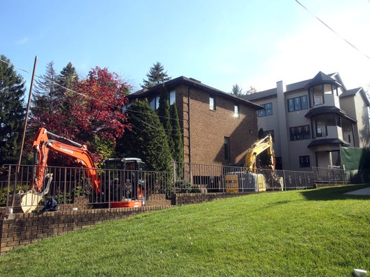 A large multifamily dwelling is being built in the backyard of the home at 19 Cedar Lane in Ramapo. The owner is constructing the five-apartment building.