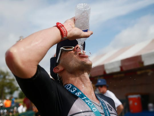 After finishing with the best time in the half triathlon, Raymond Botelho, of Falmouth, Mass. hydrates Jan. 9, 2016 in Collier County. A total of 409 registered to compete in annual HITS Triathlon Series starting in Naples at Vanderbilt Beach and ending in downtown Ave Maria.  A half triathlon include a 1.2 mile swim, 56 mile bike ride and 13.1 mile run. The full consisted of 2.4, 112 and 26.2, all miles, respectively. (Corey Perrine/Staff)
