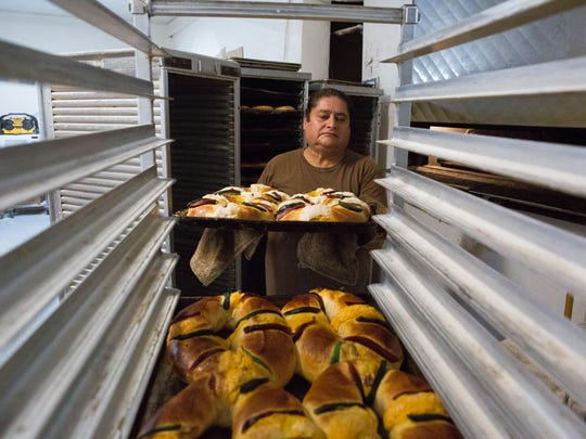 Enrique Sanchez, one of the owners of Lujan Bakery, pulls Rosca de Reyes or Kings Cake out of the oven and onto cooling racks, Friday, January 6, 2017. The bakery as of 11 am had made 1,200 Kings Cakes, in advance of the celebration of the Epiphany a religious holiday marking the visit to baby Jesus by the Three Kings.