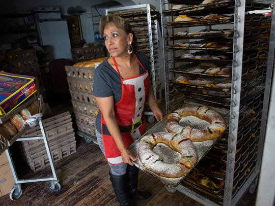 Delfina Calderon, shows a customer at Lujans Bakery