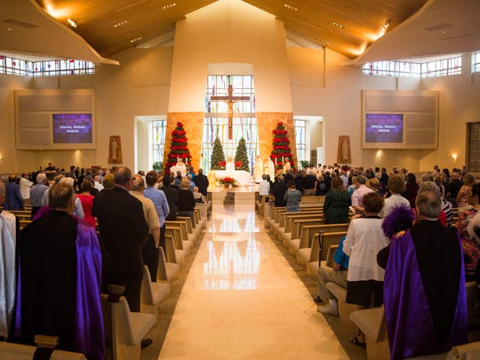 The congregation stands during Blue Mass for Law Enforcement at St. Agnes Catholic Church in Naples on Saturday, Jan. 7, 2017.