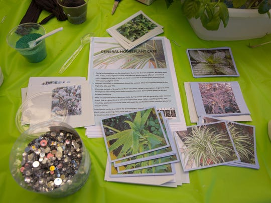 Informational packets and craft supplies laid out at the table in front of  Museum of Nature and Science, Saturday January 7, 2017, during the Branigan Culture Club, this week celebrating National House Plant Appreciation day.