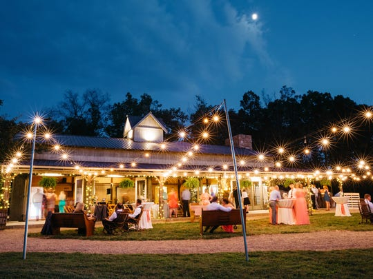 "Friends and family enjoy a relaxing celebration under the stars at The Farm in Candler, which made the exclusive ""Best of Weddings"" list compiled by TheKnot.com."