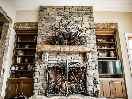 Hand-forged out of solid bronze to create a thicket of branches, vines and stems present a delightful display of delicate acorns, leaves, and tendrils in this dramatic fireplace screen by The Heirloom Companies.