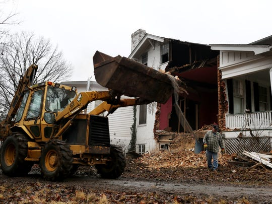 Demolition is underway at a home in the Upper Highlands