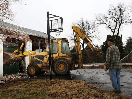 Demolition is underway on a home in the upper Highlands