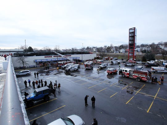 Yonkers police and firefighters respond to a roof collapse