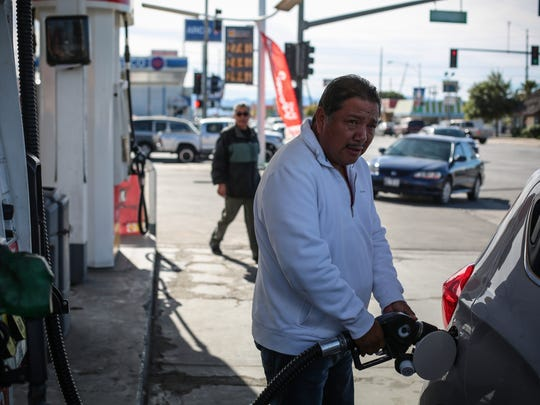 Florencio Butron, 55, of Mexicali fills up his car at the Shell gas station in the border town of Calexico, California on Wednesday, January 11, 2017. A gas price hike and protests against the hike has made supplies unreliable, across the border, in Mexicali for the past several days.