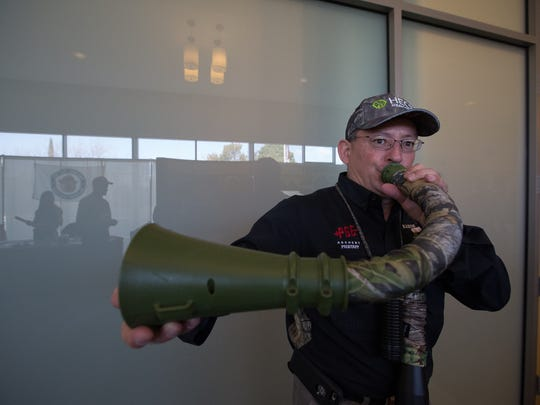 Ralph Ramos, uses an Elk call in the middle of the hallways of the Las Cruces Convention Center, before giving a seminar on Elk Hunting during the Mesilla Valley Outdoor Expo, Saturday, January 14, 2017.