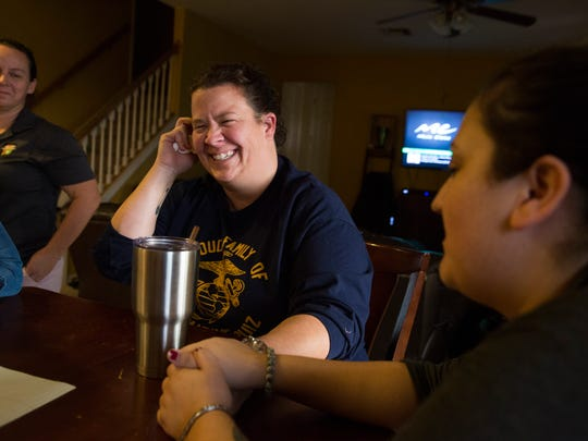 While recalling fond memories of her son, fallen Marine Austin Ruiz, Sheara Ruiz, center, and April Ruiz, right, share a laugh in the family dining room Tuesday, Jan. 17, 2017 in Golden Gate Estates. Austin Ruiz was killed Friday, Jan. 13, 2017 during a Marine training exercise in Twentynine Palms, California.