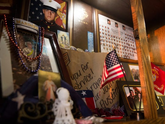 A memorial cabinet was constructed for Austin Ruiz as soon as he left for basic training and stands prominently in the Ruiz family dining room Tuesday, Jan. 17, 2017 in Golden Gate Estates. Austin Ruiz was killed Friday, Jan. 13, 2017 during a Marine training exercise in Twentynine Palms, California.