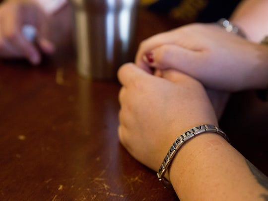 April Ruiz, sister of fallen Marine Austin Ruiz, wears an old bracelet Austin used to wear as a child. She found the bracelet while searching through his old belongings after the terrible news of his death had been relayed to the family. Austin Ruiz was killed Friday, Jan. 13, 2017 during a Marine training exercise in Twentynine Palms, California.