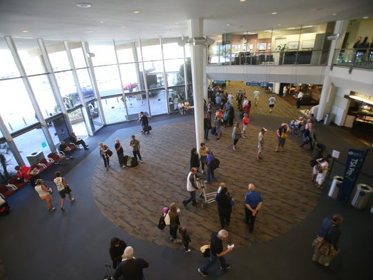 In this file photo, travelers wait for their flights at Palm Springs International Airport. The airport is home to about 100 workers employed by Airport Terminal Services, a company ordered to pay a $600,000 settlement this spring.