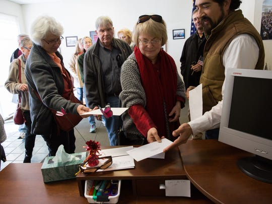 """Patricia Pettit, center, along with a group of 14 other concerned citizens from the group, """"We're In: Southern New Mexico."""" drop off letters for Congressman Steve Pearce in his Las Cruces Office, with Peter Ibarbo,right,, director of community outreach and Natural Resources, detailing their conerns about the possible lose of the Affodable Care Act, Wednesday, January 18, 2017."""