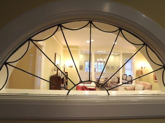 Window between interior rooms in an 1880s house at