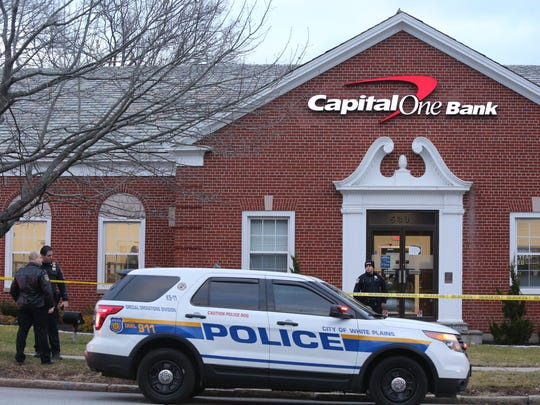 White Police officers close off Capital One Bank at
