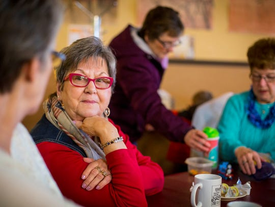 Creston resident Sharon Hower talks with friends while