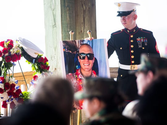 Family and friends mourn the loss of Naples Marine Austin Ruiz during a Celebration of Life service at Lovers Key State Park on Sunday, Jan. 22, 2017.